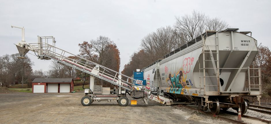 A conveyor next to a train at rest at 988 E. Center St. in Wallingford, Thurs., Nov. 14, 2019. A public hearing is scheduled for Monday to consider the suspension or revocation of the wetlands permit granted in June to Benchmark Land Development, the property owner of 988 E. Center St. Dave Zajac, Record-Journal