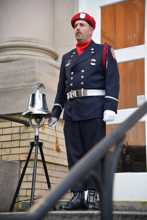 Wallingford Fire Lt. Timothy Massey rings a bell once for every 100 lives lost in the 9/11 terrorist attacks, at a remembrance ceremony at the Wallingford Town Hall on Tuesday, September 11, 2018. | Bailey Wright, Record-Journal