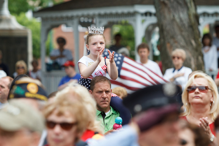 Olivis Cormier 5 sits on her dads Todd shoulders during the Memorial Day ceremonies Monday in Southington   May,26 2014 | Justin Weekes / For the Record-Journal