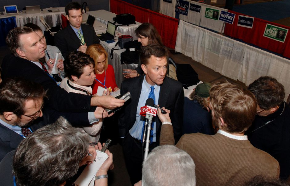Ned Lamont speaks with reporters before the Democratic State Convention in Hartford, Conn., Friday, May 19, 2006. Lamont is challenging Joe Lieberman for his parties nomination for Senate. (AP Photo/Fred Beckham)