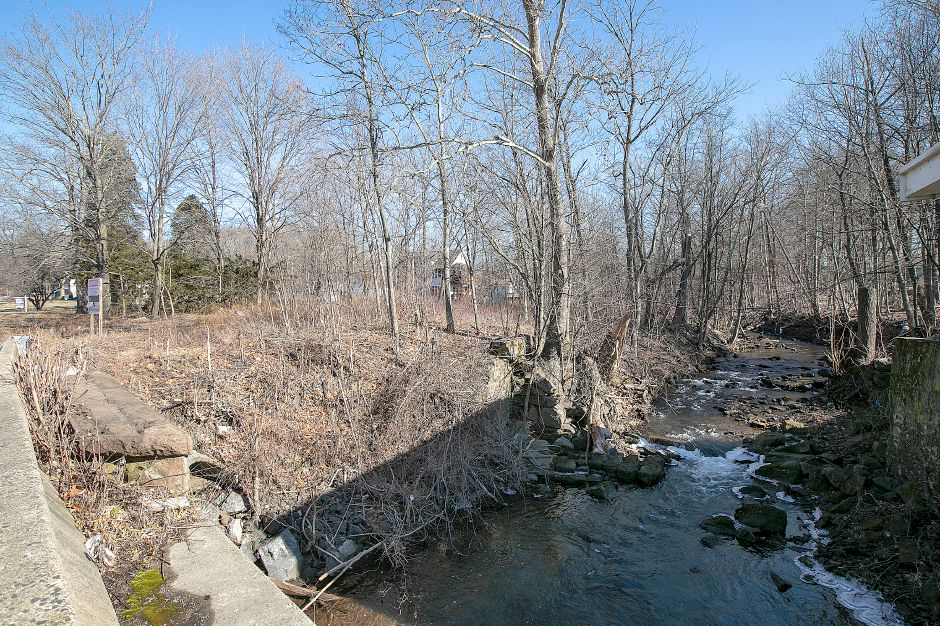 A parcel of land, left, proposed for a car wash next to Harbor Brook at 1025 N. Broad St., in Meriden, Mon. Feb. 4, 2019. Dave Zajac, Record-Journal