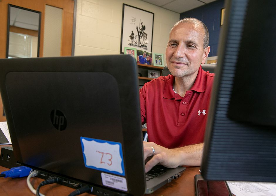 Enzo Zocco, associate principal, works at his desk at Newington High School, Tuesday, July 24, 2018. Zocco will be the new principal of Sheehan High School replacing longtime principal Rosemary Duthie, who announced last month she will retire Aug. 10 after 18 years as principal. Dave Zajac, Record-Journal