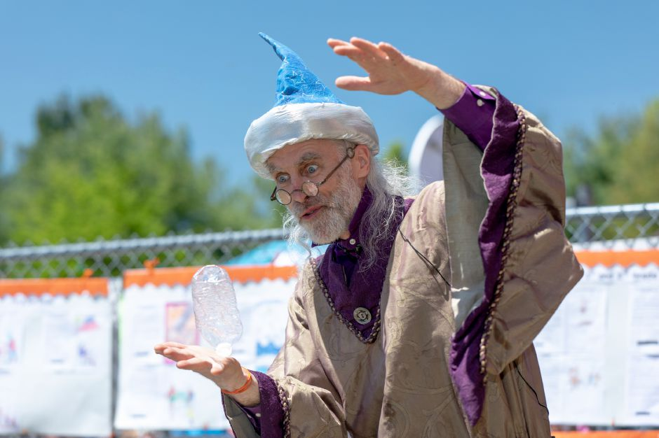 Cyril the Sorcerer shows off the magic of recycling during the Plainville schools Family Fest at Linden Street School on May 11. | Devin Leith-Yessian, The Citizen