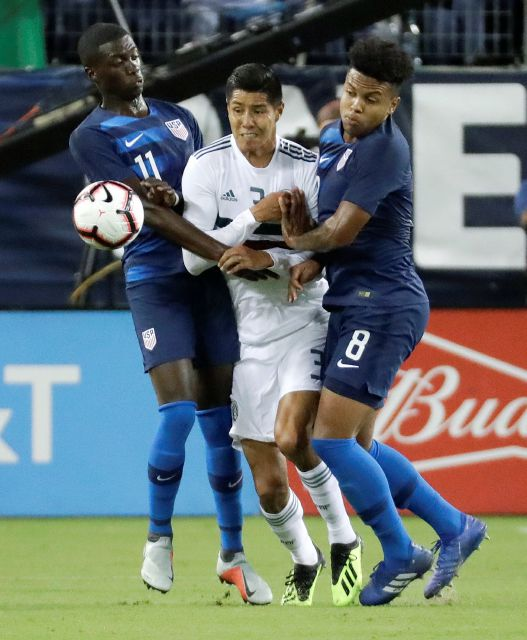 Mexico defenseman Hugo Ayala (3) battles U.S. midfielders Tim Weah (11) and Weston McKennie (8) for the ball during an international friendly match Tuesday, Sept. 11, 2018, in Nashville, Tenn. (AP Photo/Mark Humphrey)