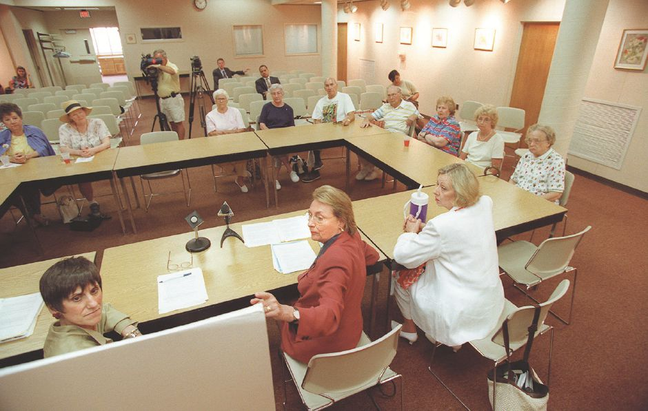 RJ file photo - U.S. Rep. Rosa DeLauro, left, points to wording on a display at the Wallingford Public Library, as gubernatorial candidate Barbara Kennelly watches, Aug. 10, 1998.