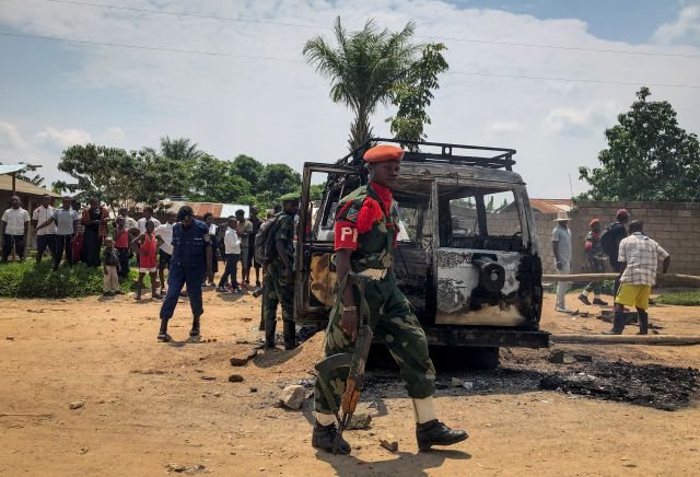 Congolese security forces attend the scene after the vehicle of a health ministry Ebola response team was attacked in Beni, northeastern Congo Monday, June 24, 2019. A driver working with the team is in critical condition after angry crowds hurled rocks at him and set the vehicle on fire, in the latest attack to strike efforts to combat the virus that has killed more than 1,500 people in eastern Congo since the outbreak began last August. (AP Photo/Al-hadji Kudra Maliro)