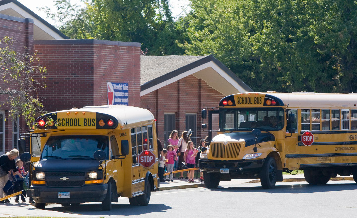 Students board buses during dismissal at Hatton School in Southington, Monday afternoon, September 15, 2014. School administration is going to work on establishing a new protocol for when buses are running late. |  Dave Zajac / Record-Journal
