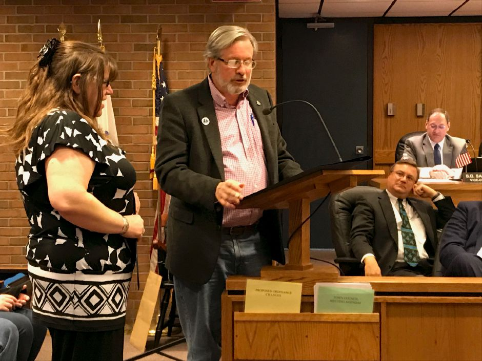 Plainville resident and executive director of PARC, Erica Donovan was honored at a Town Council meeting for her donations to Toys for Tots and the ripple effect it caused. |Ashley Kus, The Citizen