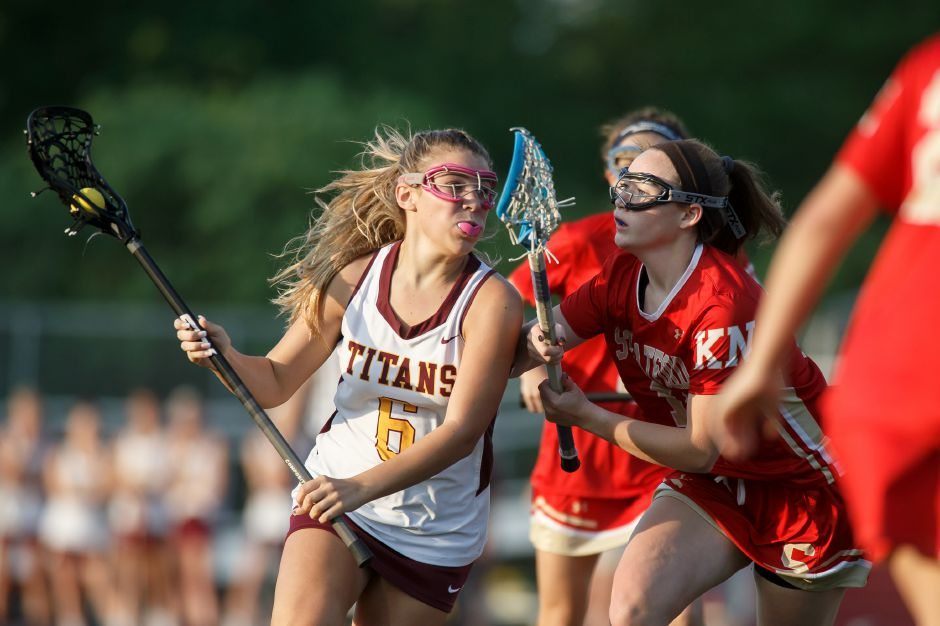 Madison Gaynor recorded a hat trick in the Sheehan girls lacrosse team's 12-4 victory Friday over Windsor. The Titans completed the regular season at 12-4 and open the postseason on Saturday night in Branford in the first round of the SCC Tournament. | Justin Weekes / Special to the Record-Journal