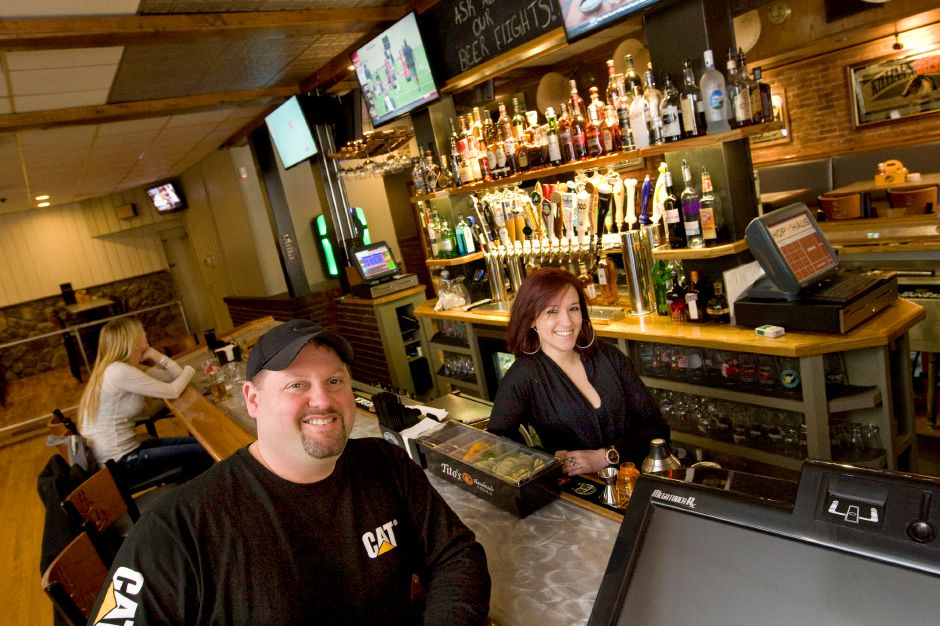 FILE PHOTO: Mike Miller, owner of Hop Haus Restaurant & Craft Beer and bartender, Chantal Distefano at the new pub located at 28 West Main ST., Plantsville, Thursday, March 27, 2014. | Dave Zajac / Record-Journal