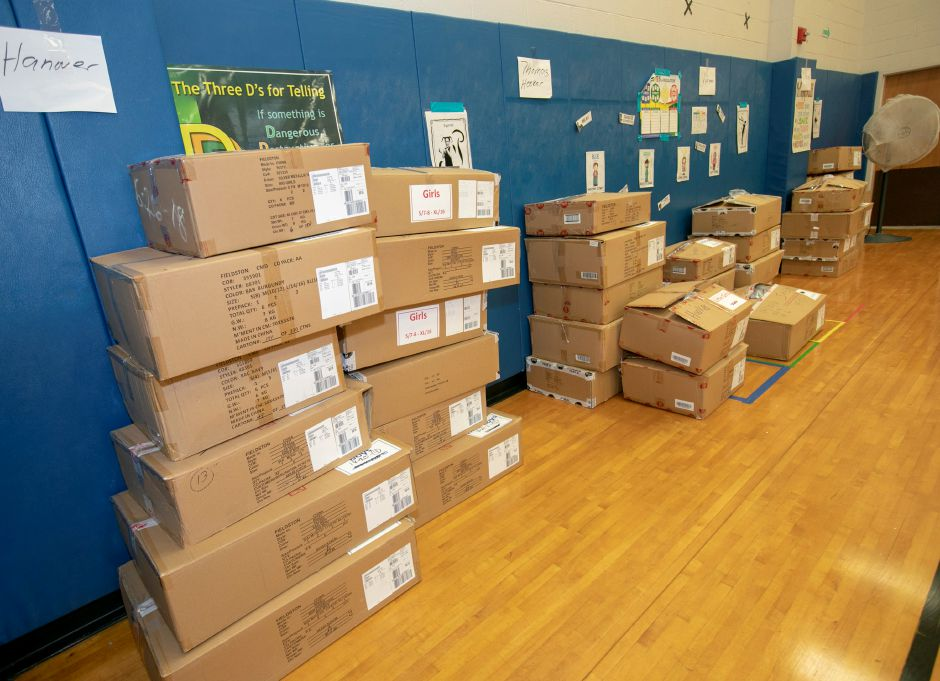 Boxes of coats ready for distribution during the annual coat donation by the Dalio Foundation at Hanover School in Meriden, Thursday, Oct.11, 2018. Over one thousand children in Meriden's public school system received brand new coats on Thursday to prepare for the winter months. Dave Zajac, Record-Journal