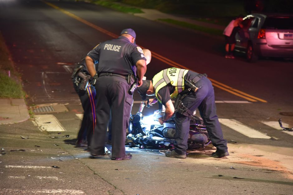Emergency crews respond to a crash involving a motorcycle at the intersection of Broad Street and Liberty Street in Meriden Wednesday, July 11. | Bailey Wright, Record-Journal