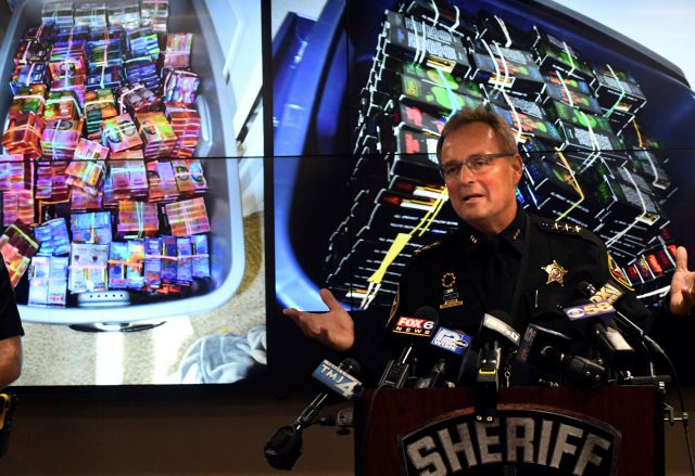 Kenosha County Sheriff David Beth talks about the THC-infused vaping cartridges that were part of a large-scale marijuana operation during a news conference in Kenosha Wednesday, Sept. 11, 2019. (Paul Williams/The Kenosha News via AP)