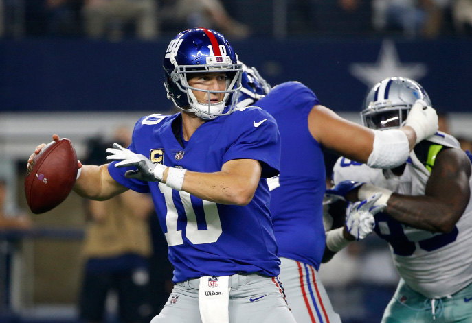 New York Giants quarterback Eli Manning (10) throws a pass in the second half of an NFL football game against the Dallas Cowboys on Sunday, Sept. 10, 2017, in Arlington, Texas. (AP Photo/Ron Jenkins)