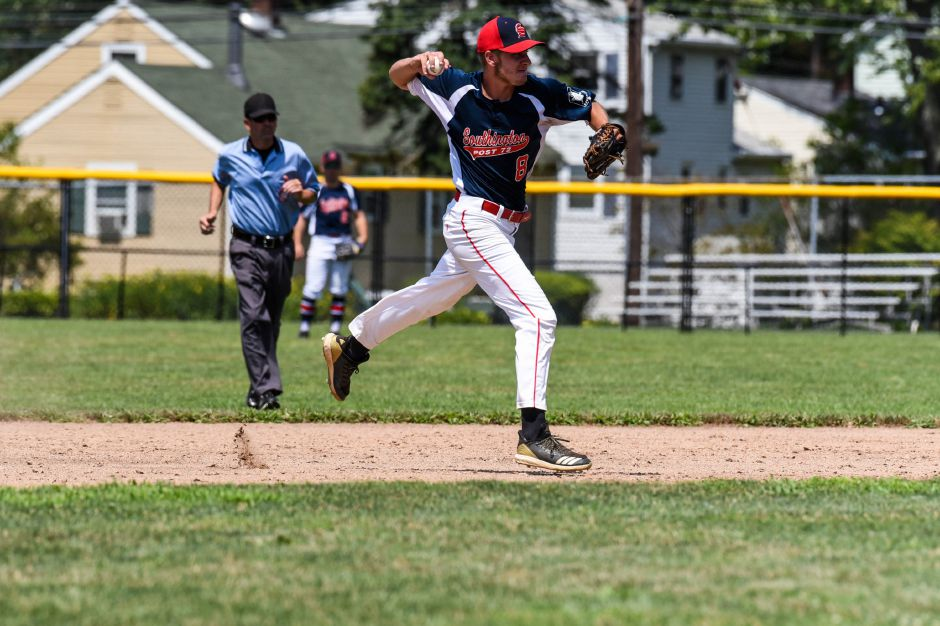 Jacob Romano throws a ground ball to first for Southingtons American Legion team against Stamford at Ceppa field