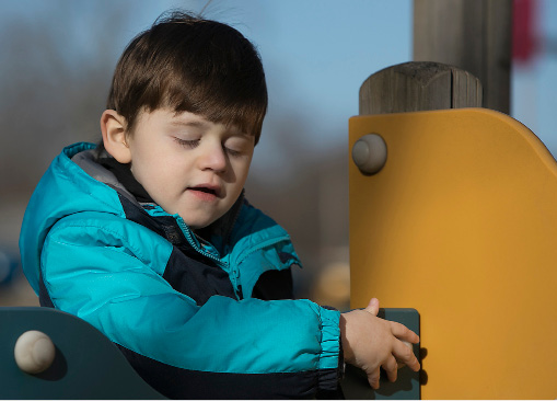 Collin Reilly, 7, of Wallingford, feels his way around a playscape at Doolittle Park in Wallingford, Thursday, March 23, 2017. Collin became permanently blind at six months old after doctors performed surgery to remove cancer tissue from his brain, which they warned could happen prior to surgery. A fundraiser for Collin is being held at Serenity Salon and Day Spa, 118 Center Street, this Sunday from 10 a.m. to 3 pm. | Dave Zajac, Record-Journal