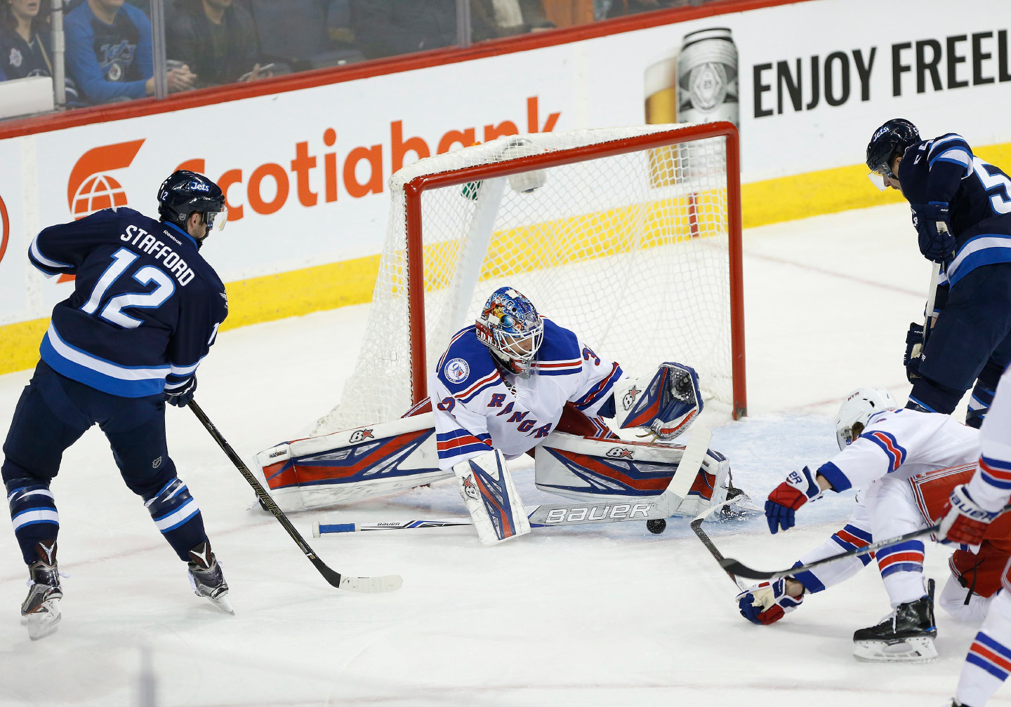 New York Rangers goaltender Antti Raanta (32) stops the pass from Winnipeg Jets