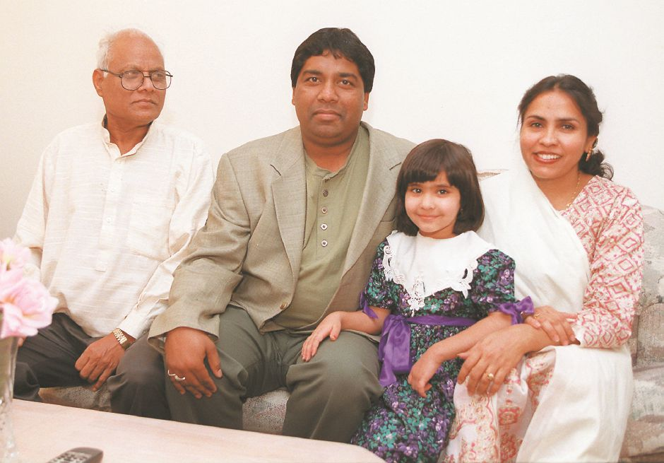 RJ file photo - Salman Abbas with his father, Mohammed Kaunain, daughter Fatima, 4, and wife Zarrin, in their Meriden home, Dec. 1998.