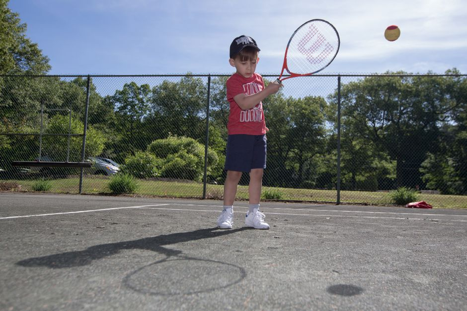 Evan Cortes 4 of Wallingford practices his forehand Sunday during the Wint Filipek Sr. Tennis free clinic at Copper Valley Tennis Club in Cheshire Jun. 4, 2017 | Justin Weekes / For the Record-Journal