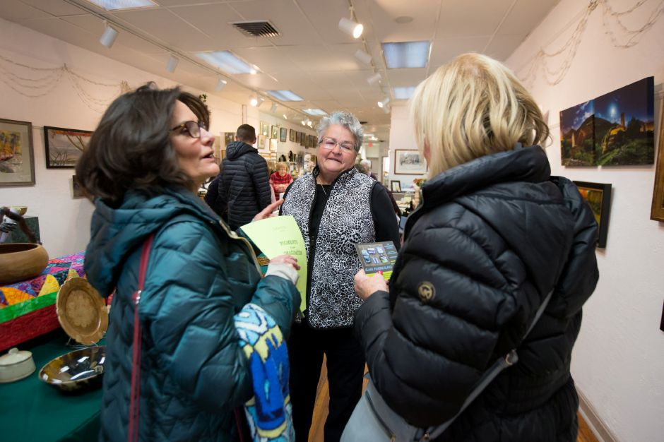 Chris Webster, center, president of Gallery 53, talks with Nanette Berdew, left,  of Wallingford, and Danielle Flagg, of Meriden, at the gallery on Saturday.