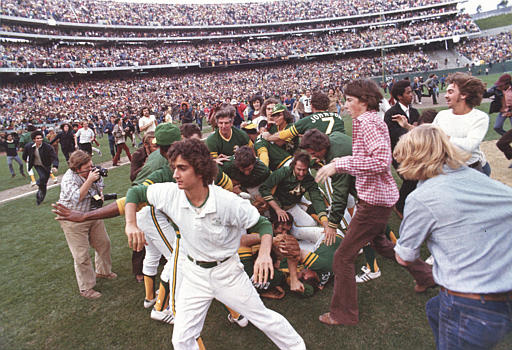 Oakland Athletics swarm over each other in a mad frenzy after they defeated the New York Mets in the final game of the World Series in Oakland, Calif., on Oct. 21, 1973. The A