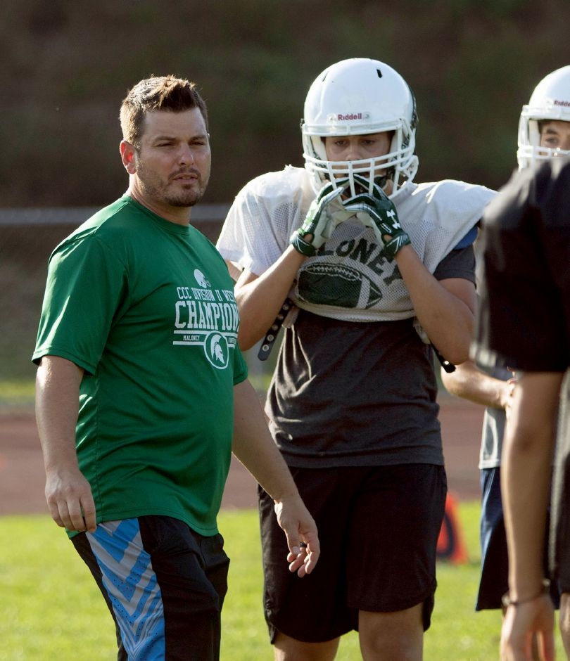 Maloney High School head head football coach Kevin Frederick talks with players during football practice on Monday August 26, 2019. Aaron Flaum, Record-Journal
