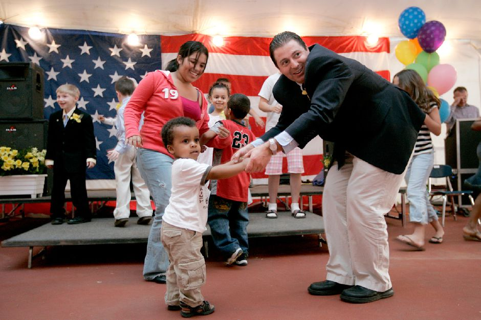 "File photo - 4.23.08 - Meriden Mayor Mark Benigni, dances the ""Chicken Dance"" with Avery Ijeh, 22, months, near Serena Chabla at the Little Miss Daffodil event at Hubbard Park as one of his last official appearences as mayor."