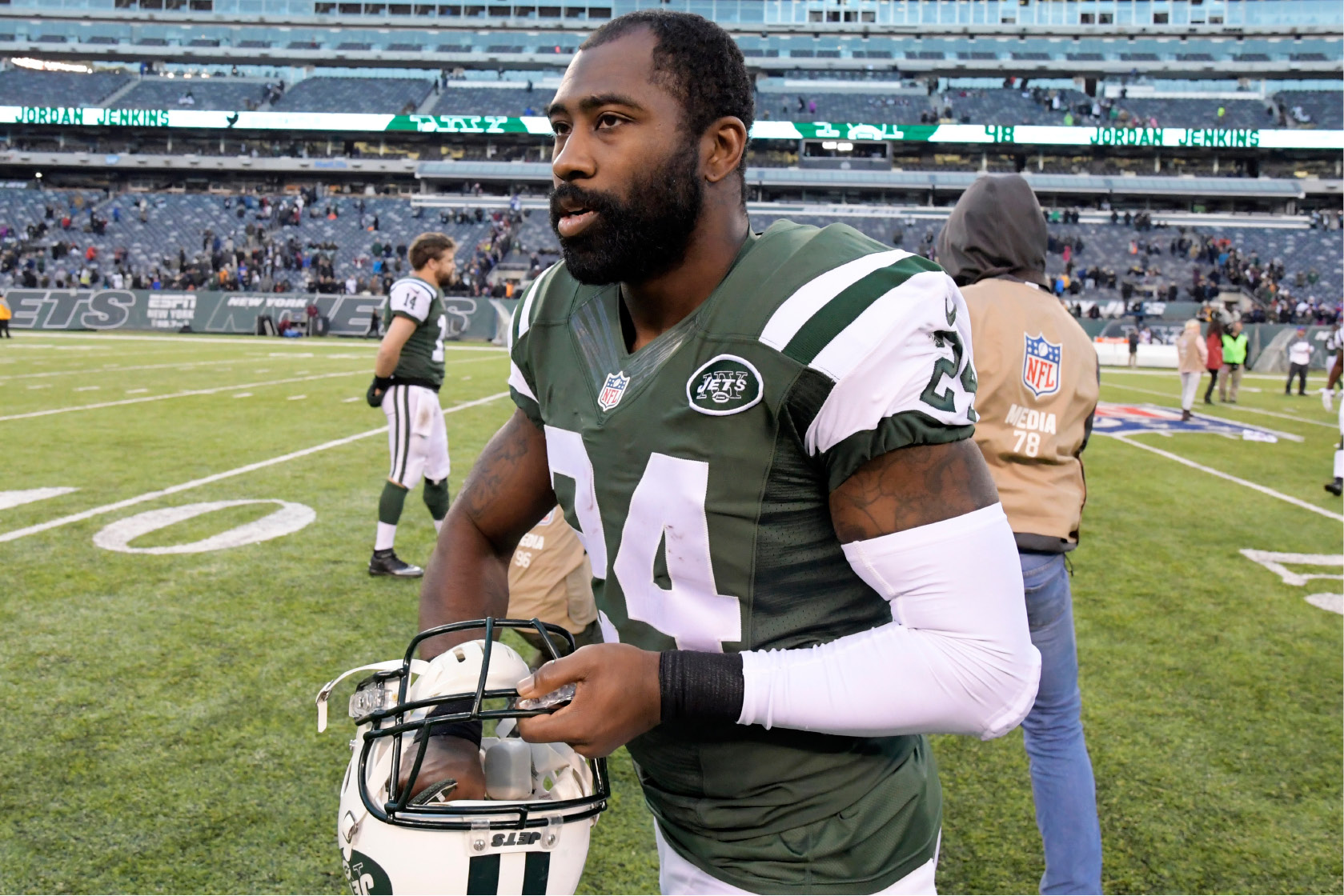 FILE - In this Sunday, Jan. 1, 2017, file photo, New York Jets cornerback Darrelle Revis walks on the field after an NFL football game against the Buffalo Bills in East Rutherford, N.J. Revis has a court date in Pittsburgh on Wednesday, March 15, 2017, on charges alleging he was in a fight with two men in Pittsburgh last month. The Jets released the former University of Pittsburgh star shortly after the Feb. 12 incident and he's yet to sign with another team. (AP Photo/Bill Kostroun, File)