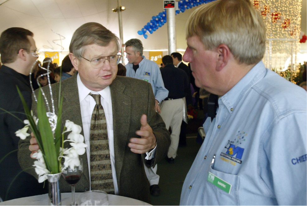 Meriden City Manager Roger Kemp, left, with Mark Zebora, right, Director of Parks and Rec. Thurs., April 24 at the Daffodil Festival reception.