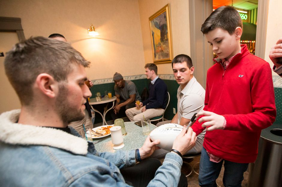 Jack Brooder, 10, of Wallingford gets an autograph from Danny Etling, the backup quarterback with the New England Patriots, Friday during the United Way NFL dinner and silent auction at Zandri