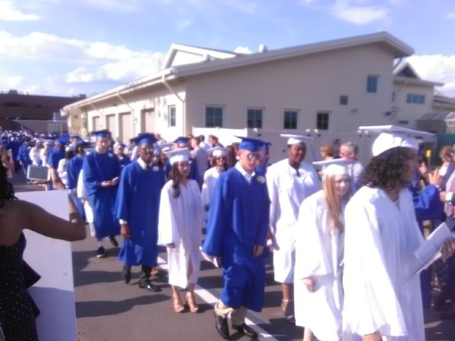 Southington High School students walk before graduation. | Jesse Buchanan, Record-Journal