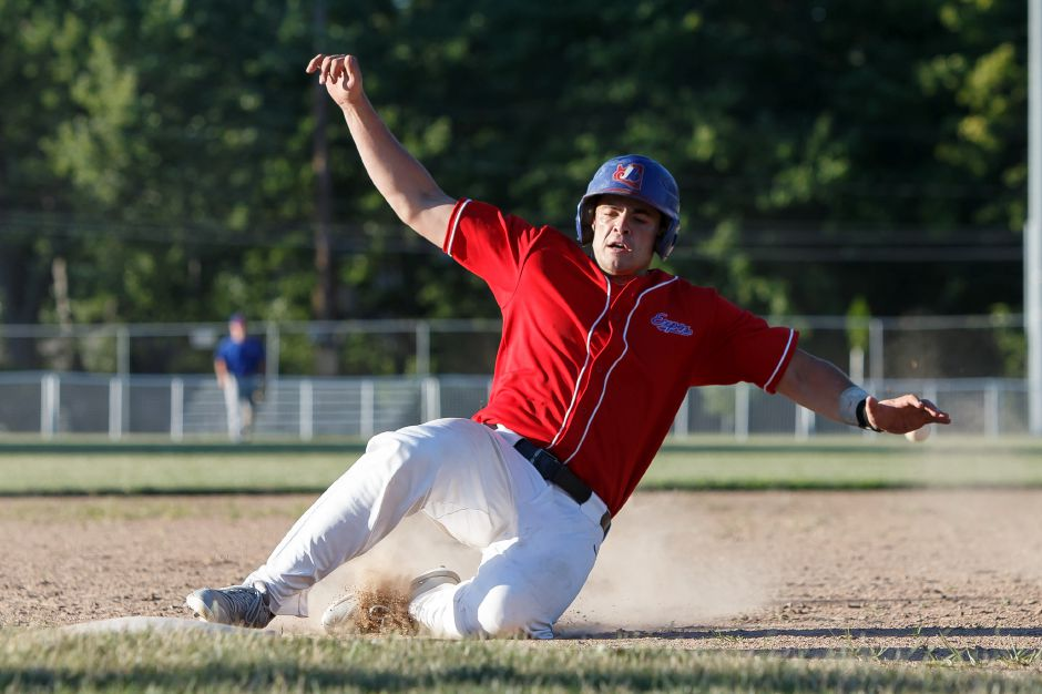 Mike Gulino of the Record-Journal Expos slides into third base Thursday at Ceppa Field during a Greater Hartford Twilight Baseball League game against People's United Bank. Gulino slugged a three-run homer in the R-J's 5-4 victory. | Justin Weekes / Special to the Record-Journal