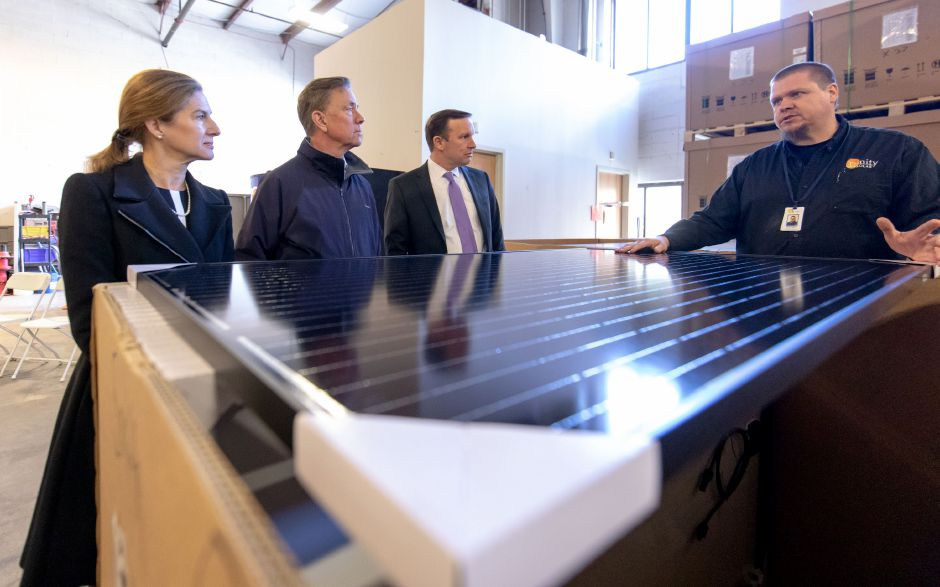 James Star, manager of Trinity Solar in Cheshire, speaks to Democratic Lt. Gov. candidate Susan Bysiewicz, Gubernatorial candidate Ned Lamont and Senator Chris Murphy. The three Democrats toured the company and spoke about the importance of clean energy on Oct. 25, 2018. | Devin Leith-Yessian/Record-Journal