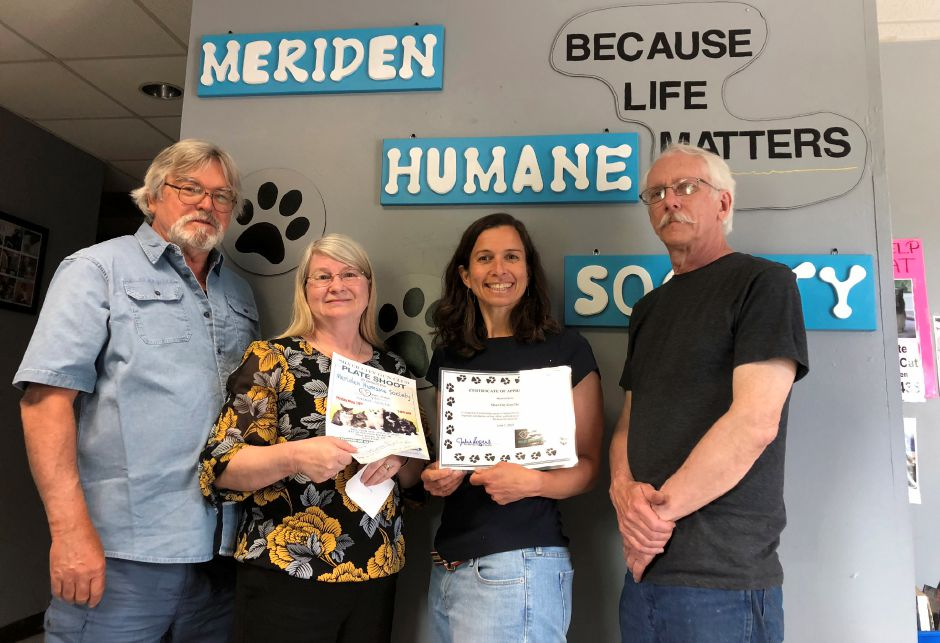 Roger Bradbury, president of the Gun Club, Joan Crebase, treasurer, Julie Rogers of the Meriden Humane Society, and Bruce Bilyard of the Gun Club.