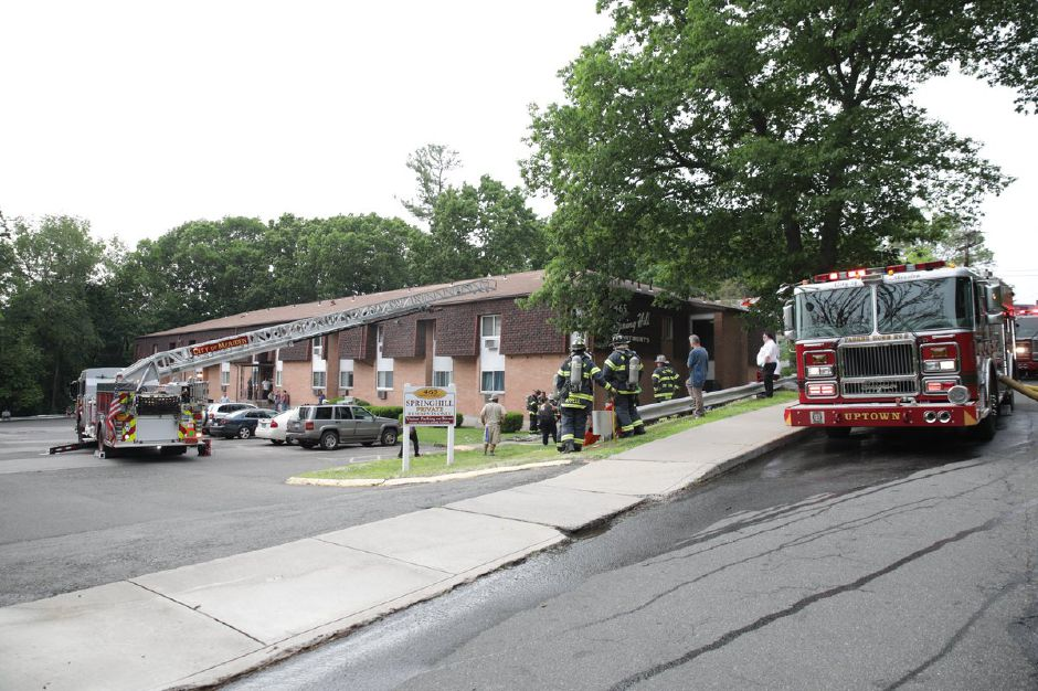 Firefighters work at the scene of an apartment fire on Crown Street in Meriden on Wednesday afternoon. Devin Leith-Yessian, Record-Journal.