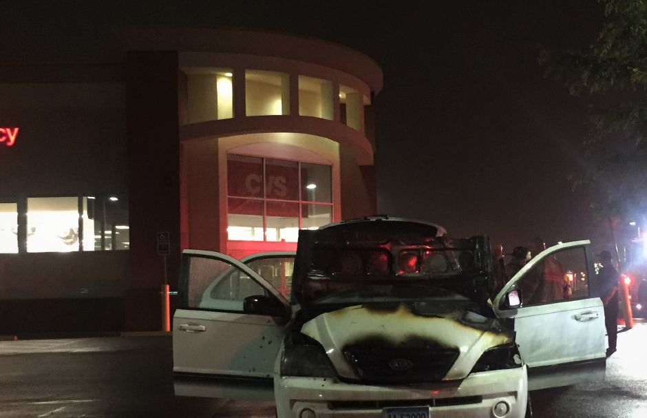 Emergency crews respond to a vehicle fire in a CVS parking lot at 891 North Colony Road in Wallingford Thursday night. | Bailey Wright, Record-Journal
