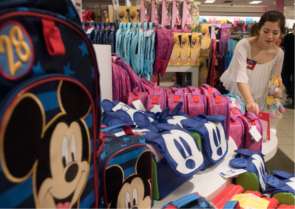 Employee Krystal Galaz straightens a display of lunch boxes and backpacks at JC Penney inside the Broadway Square Mall in Tyler, Texas Thursday Aug. 10, 2017. Tax Free Weekend is August 11th-13th with extended shopping hours at Broadway Square Mall. The sales tax holiday coincides with back to school shopping. (Sarah A. Miller/Tyler Morning Telegraph via AP)