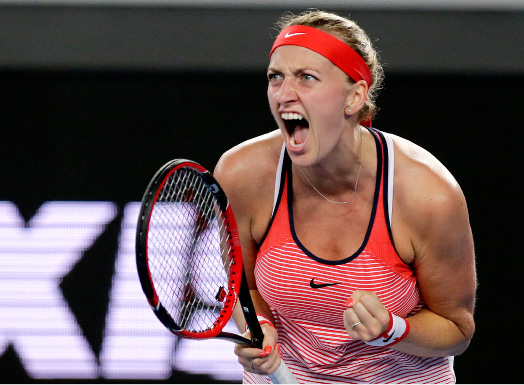 FILE - This is a Wednesday, Jan. 20, 2016 file photo of Petra Kvitova of the Czech Republic, clenches her left hand as she reacts after winning a point against Daria Gavrilova of Australia during their second round match at the Australian Open tennis championships in Melbourne, Australia. Two-time Wimbledon champion Petra Kvitova has been injured by a knife-wielding attacker at her home on Tuesday Dec. 20, 2016. The player