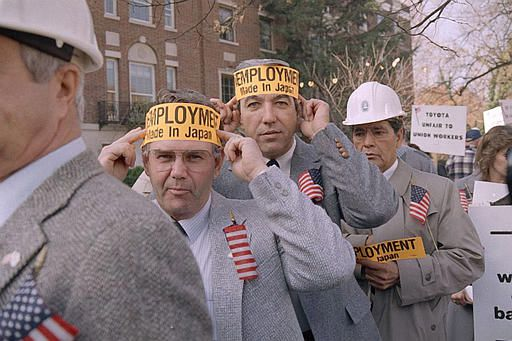 Wayne Pierce, left, and Leo Becker, both members of the building trade unions in the United States, take part in a demonstration in Washington at the Japanese Embassy, Nov. 17, 1986, aimed at the Toyota Corp. and the Ohbayashi Corp., the company building the $800 million assembly plant in Scott County, Ky. (AP Photo/Dennis Cook)