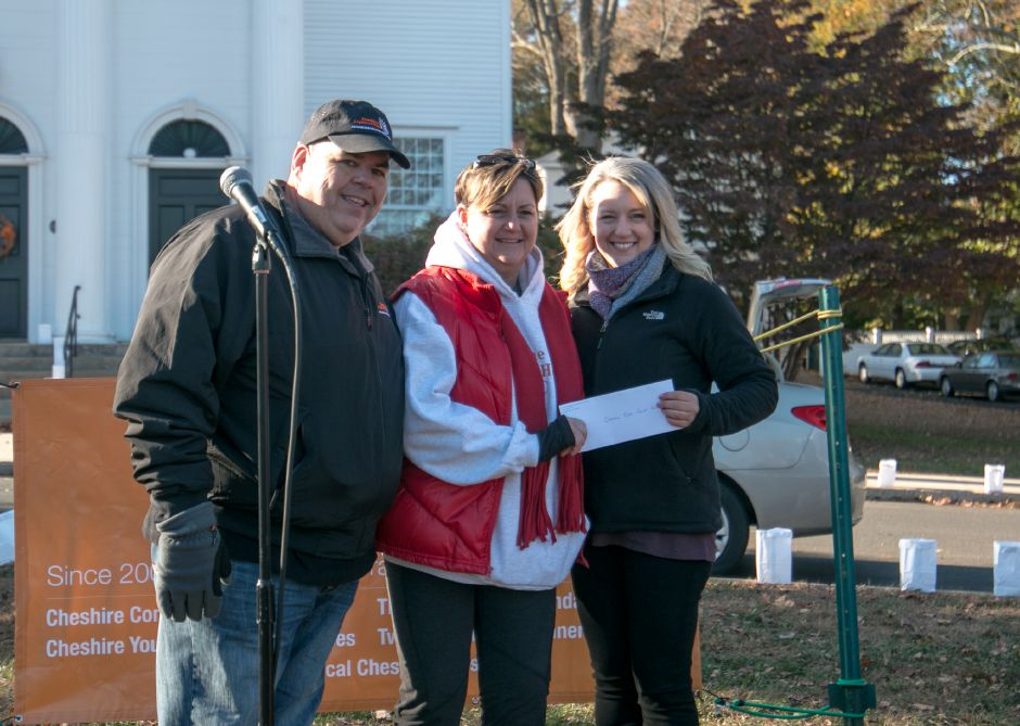 Don and Jenifer Walsh present a donation from Lights of Hope, of which they are the president and vice president, to Kristen Schechter of Cheshire Youth and Social Services. Lights of Hope held its yearly Mile of Hope, where luminaries are placed alongside Route 10 between downtown Cheshire and the town
