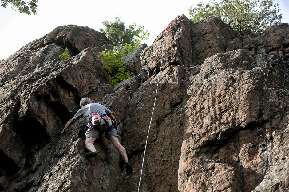 FILE PHOTO: Albert Carilli, of Terryville, climbs a cliff face on Ragged Mountain in Southington with Connecticut Climbers & Mountaineers, Wednesday, June 28, 2017. | Dave Zajac, Record-Journal