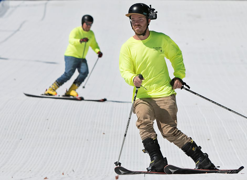 Chad Snyder, terrain park manager, right, and Tom Loring, training center director, take a test run on the new 365 Synthetic Snow Park trail at Powder Ridge Mountain Park & Resort in Middlefield, Thursday, Sept. 1, 2017. The park opens at noon on Saturday. | Dave Zajac, Record-Journal