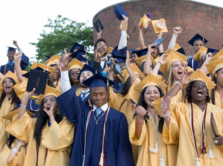 Members of the Platt High School Class of 2016 celebrate at conclusion of graduation ceremonies in front of the school, Thursday, June 9, 2016. | Dave Zajac, Record-Journal