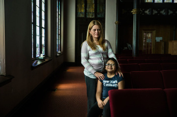 Nury Chavarria poses for a photo with her 9-year-old daughter, Hayley, inside La Iglesia de Dios Pentecostal church on Wednesday, July, 26, 2017, in New Haven, Conn. Nury Chavarria, a housekeeper and mother of four who received sanctuary in the church, on Wednesday was granted an emergency stay of a deportation order that would have sent her back to her native Guatemala. (Lauren Schneiderman/Hartford Courant via AP)