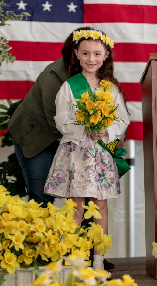 Ben Franklin Elementary School student Scarlett Gibbs, 7, is crowned Little Miss Daffodil at a ceremony on April 24, 2019 in Hubbard Park. Gibbs will lead the Meriden Daffodil Festival Parade on April 27, being escorted by Israel Putnam student Kayden Rodriguez, 8. | Devin Leith-Yessian/Record-Journal
