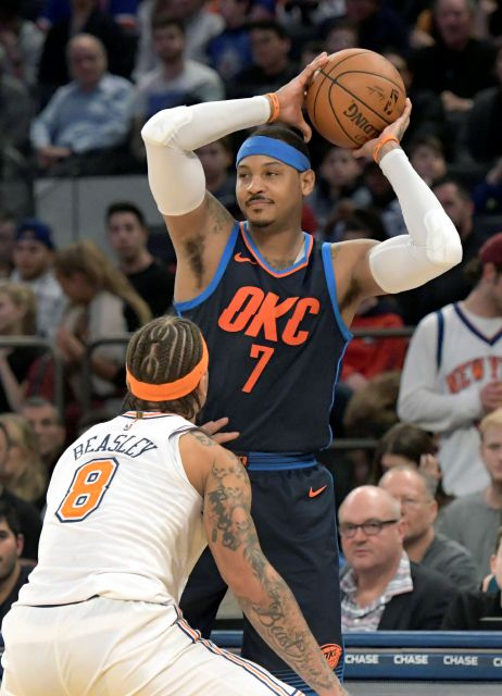 Oklahoma City Thunder forward Carmelo Anthony (7) looks to pass the ball as he is guarded by New York Knicks forward Michael Beasley (8) during the second quarter of an NBA basketball game Saturday, Dec.16, 2017, at Madison Square Garden in New York. (AP Photo/Bill Kostroun)