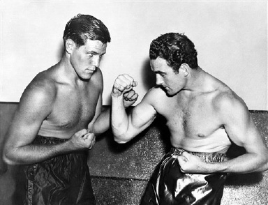 American boxer Buddy Baer, left, and Great Britain