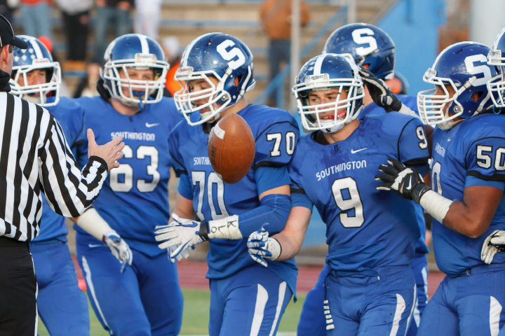 Southington's Alex Jamele (9) is congratulated by teammates after scoring a touchdown during the CIAC Class LL semifinal Saturday at Ken Strong Stadium in West Haven. | Justin Weekes / For the Record-Journal
