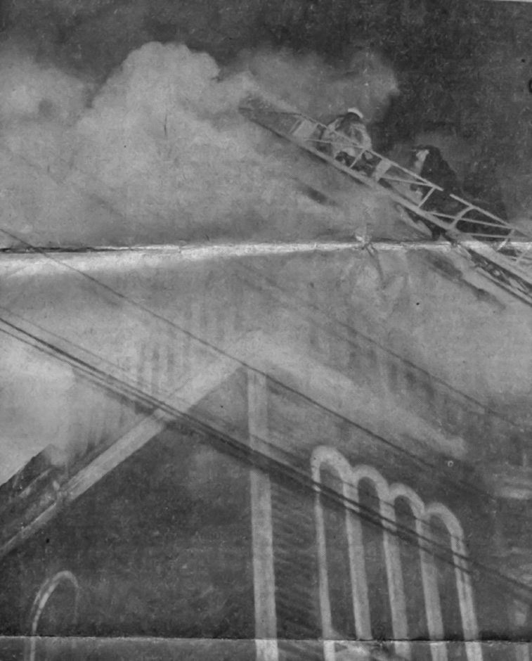 The white hat of Assistant Chief Arthur Sarrazin shows through the smoke as the veteran firefighter leads his men up the ladder to pour water on the blaze at Mount Hebron Baptist Church, Jan. 9, 1958.