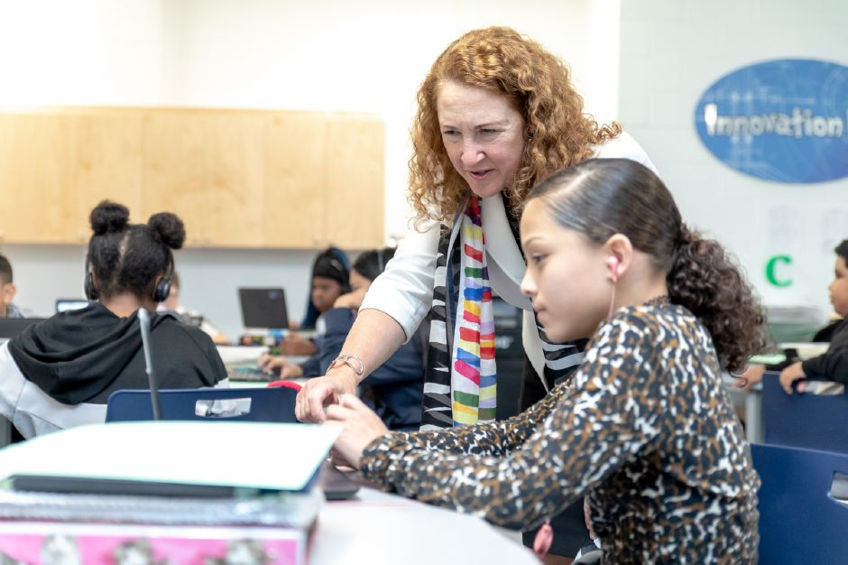 Representative Elizabeth Esty asks Mey Figueroa, 11, about a coding project during a visit to the STEM lab at Lincoln Middle School in Meriden on Oct. 22, 2018. | Devin Leith-Yessian/Record-Journal